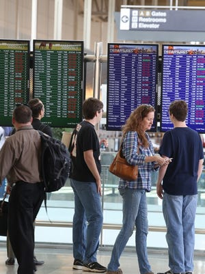 Delta passengers check the status of their flights from CVG.