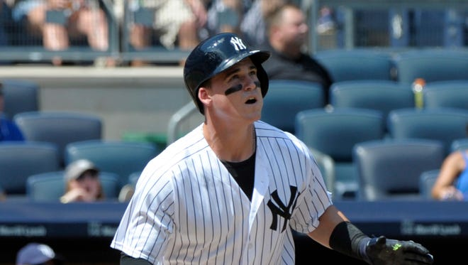 New York Yankees' Tyler Austin watches his home run as he rounds the bases during the second inning of a baseball game against the Tampa Bay Rays Saturday, Aug.13, 2016, at Yankee Stadium in New York.