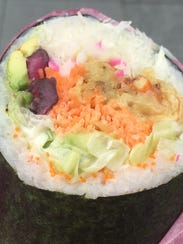 This sushi burrito is an example of Asian-Mexican fusion
