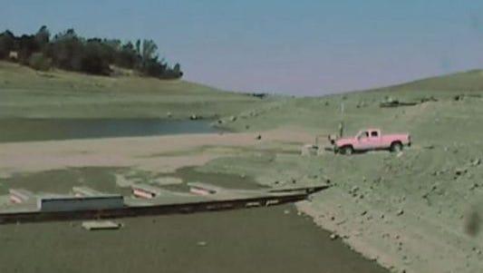 The very low water level at Folsom Lake near Sacramento.