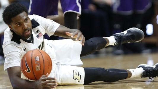 Johnny Hill falls to the floor after being fouled by Alex Olah of Northwestern Tuesday, February 16, 2016, at Mackey Arena. Purdue defeated Northwestern 71-61.