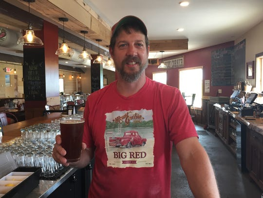 Brad Kleinfelter, head brewer at Mount Gretna Craft Brewery, proudly displays his new beer, Blue Eyed Six.