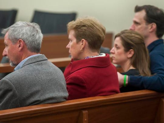 The family of David Compton sits in court during a hearing for James Stuart, a Deptford police officer charged with fatally shooting Compton in January 2013, at the Gloucester County Justice Complex on Monday, March 24, 2014.