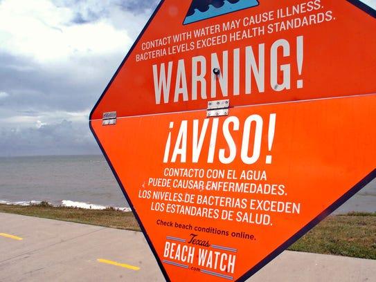 Signs by the Texas Beach Watch.com  mark areas where