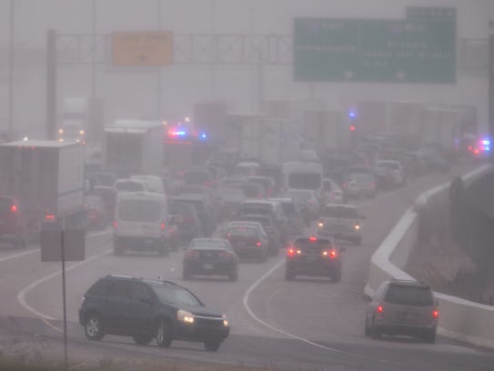 Fog and stopped traffic a few hundred meters from a