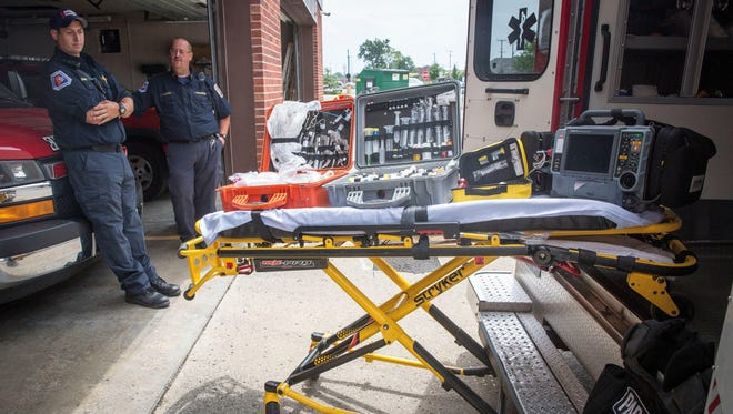 Paramedics with Delaware County EMS stand next to crates of gear used to stock their ambulances to treat a wide range of injuries from heart attacks to shootings. Mayor Dennis Tyler is considering creating a city-based ambulance service, which would take over duties normally done by the Delaware County EMS.