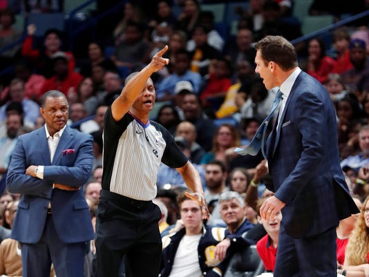 A referee ejects Los Angeles Lakers coach Luke Walton, right, as New Orleans Pelicans coach Alvin Gentry watches, left, in the first half of an NBA basketball game in New Orleans, Wednesday, Feb. 14, 2018. (AP Photo/Gerald Herbert)
