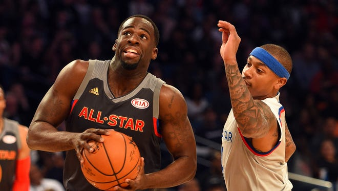 Draymond Green, left, drives to the basket past Isaiah Thomas in the NBA All-Star Game on Feb. 19, 2017, in New Orleans.