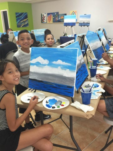 Budding painters from the Flores family gatherefor