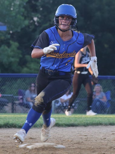 Martensdale-St. Marys junior Kailey Walker rounds second