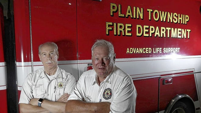 Jack Rupp (left) will take over as chief of the Plain Township Fire Department when John Hoovler retires July 24.