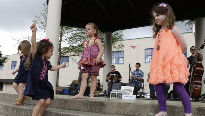 Darce LeBlanc, Hope Terrebone, Madelyn Lyons and Hailey Guidry dance to Les Freres Michot during the first Bach Lunch of the season at Parc San Souci in downtown Lafayette Friday, March 10, 2017.