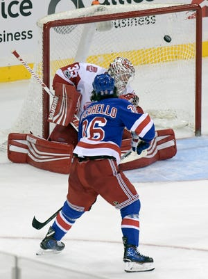 New York Rangers right wing Mats Zuccarello scores the winning goal past Detroit Red Wings goalie Jimmy Howard in overtime.