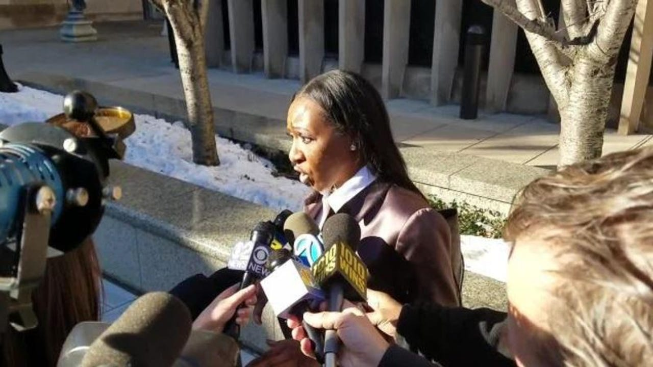 Attorney Shevelle McPherson talks with reporters after her client, Khalil Wheeler-Weaver, pleaded not guilty to a second murder charge on Dec. 20.
