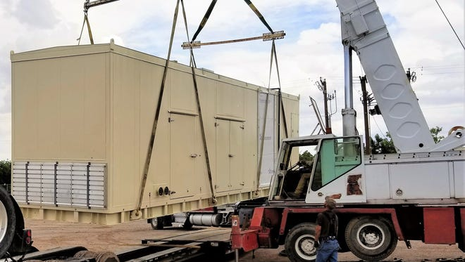 One of the two 65,000-pound generators manufactured in Austria and now in the process of being installed at the wastewater treatment plant in Las Cruces to provide power onsite from the methane gas that comes off the sewage.