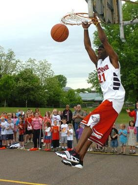 """Melvin """"The Helicopter"""" Levett dunks one in 2008 at J.F. Dulles Elementary School in Green Township, as part of an Enrichment Day program on the science of sports. Former UC star Levett will lead the Bearcat Jam team into the annual TBT basketball event this weekend in Columbus."""