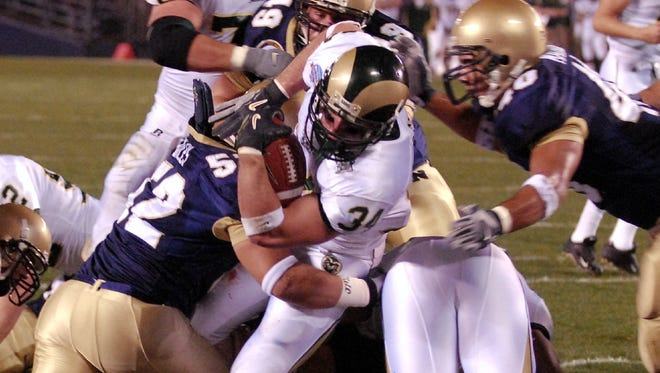 CSU running back Kyle Bell powers his way through the Navy defense on a 2-yard touchdown run in the inaugural Poinsettia Bowl in 2005. Organizers announced Wednesday that the bowl game will no longer be played, allowing them to focus their efforts on San Diego's other bowl game, the Holiday Bowl.