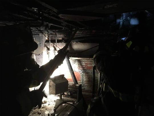 Elmira firefighters battled a basement fire late Friday