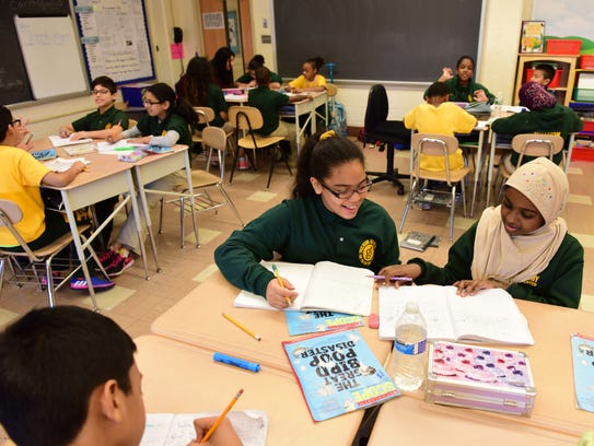 Center, Euribel Diaz, a 5th Grader at the Paterson