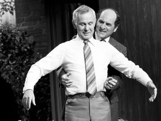 4. Dr. Henry Heimlich demonstrates the Heimlich Maneuver