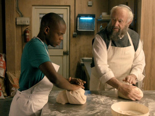 "Jerome Holder and Jonathan Pryce star in ""Dough."" The"