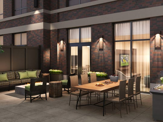 An artist's rendering of a terrace suite patio at Lodge Kohler, under construction in the Green Bay Packers' Titletown District.
