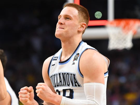 Donte DiVincenzo celebrates after defeating the Michigan Wolverines in the championship game of the 2018 men's Final Four on April 2, 2018.