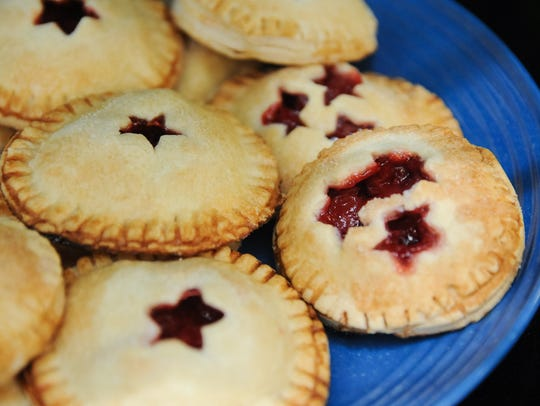Pictured are mini cherry pies made at Green Door Bakery