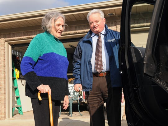 Port Huron Director of Public Safety Michael Reaves shows Dorothea Knight the new K9 vehicle Wednesday, April 13, at her home in St. Clair Township.