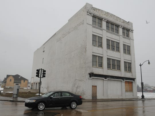 The old Miles Kimball building sits vacant on the corner