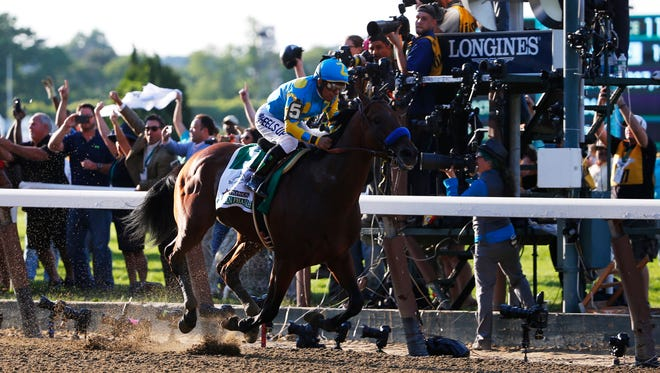 Victor Espinoza aboard American Pharoah wins the 2015 Belmont Stakes.
