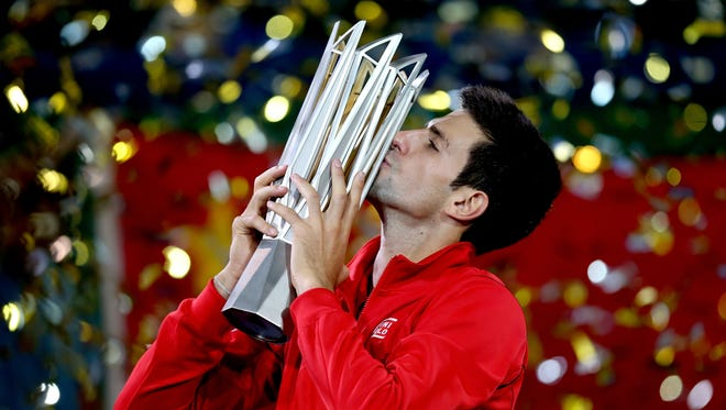 Novak Djokovic of Serbia poses for photographers after defeating Juan Martin Del Potro of Argentina in the final of the Shanghai Rolex Masters.