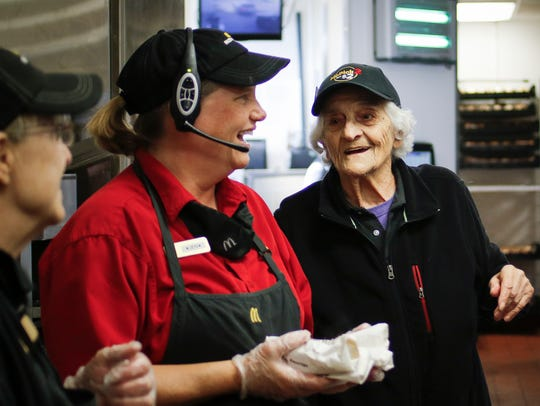 Mary Smith, 92, of Webberville jokes with fellow employees