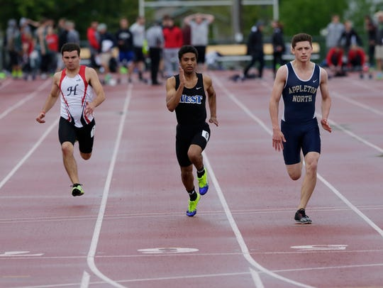 Oshkosh West's Evan Wendland runs in the boys 100 prelims during the 2017 FVA track and field meet.