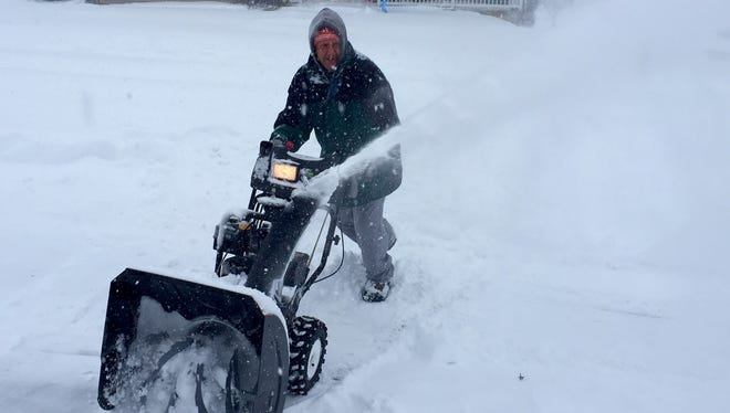 Chris Markey of Manchester Township clear's a neighbor's driveway at the height of the Blizzard of '16.