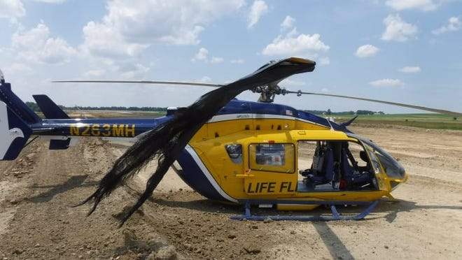 Wayne County Airport Manager Amanda McGee took this photo shortly after the Metro Life Flight made an emergency landing due to a silt construction fence getting wrapped in its blades.
