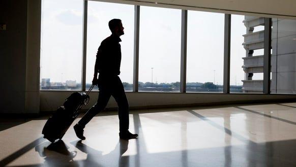 A traveler passes through Philadelphia International