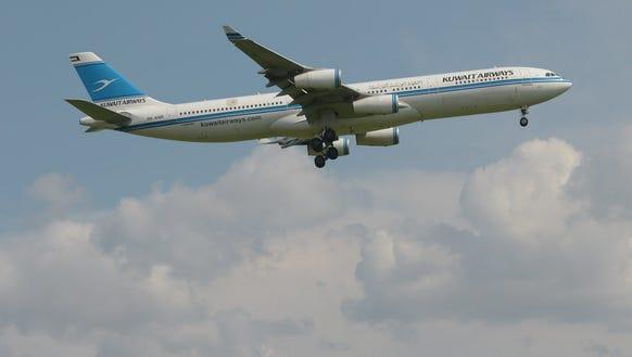 A Kuwait Airways plane lands March 18, 2013, at Sukarno-Hatta