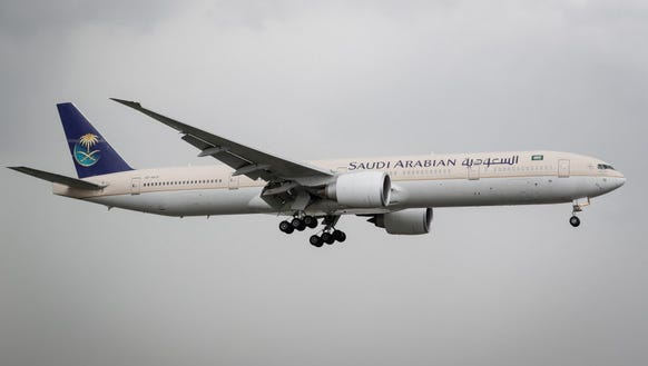 A Saudi Arabian Airlines jet prepares to land at the