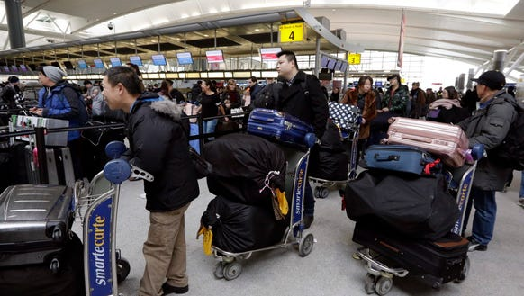 Passengers at New York's John F. Kennedy Airport Terminal