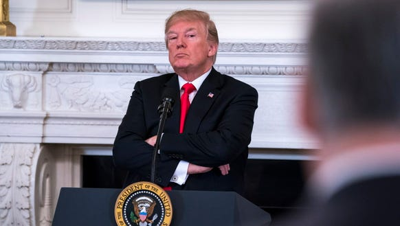 President Trump listens to a statement from Washington