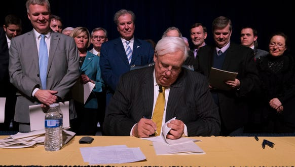 Gov. Jim Justice signs a bill increasing state workers