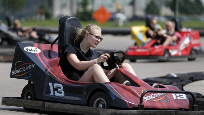 Hannah Degroot, 16, takes a ride around the go-kart track at Badger Sports Park in Appleton Wednesday.