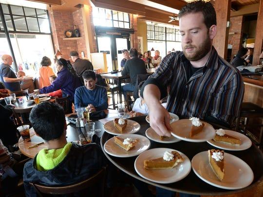 Chris Williams of Fort Collins serves pumpkin pie to
