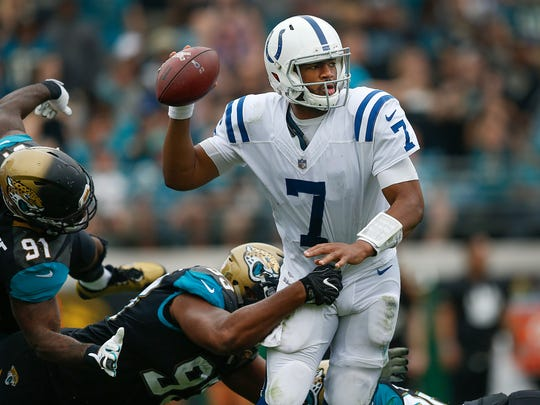 Indianapolis Colts quarterback Jacoby Brissett (7) gets rid of the ball before getting sacked by Jacksonville Jaguars defensive end Calais Campbell (93) in the second half of their game at EverBank Field on Sunday, Dec. 03, 2017.