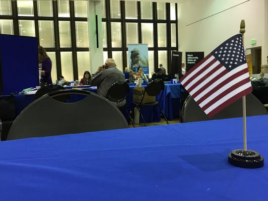 An American flag sits out on an empty table during the inaugural veterans job fair. More than 140 veterans attended.