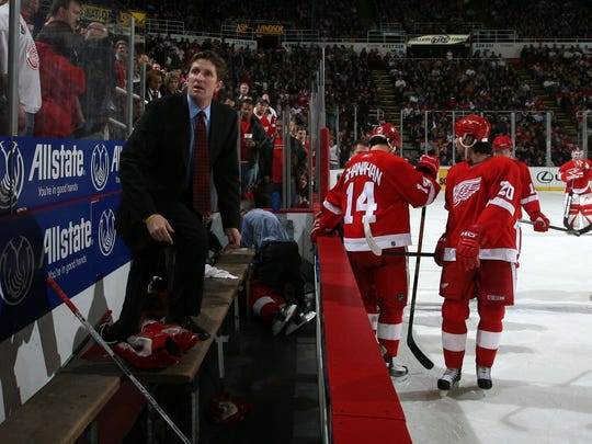 Detroit Red Wings coach Mike Babcock looks to the other bench to inform them to clear the ice as medical personnel work on collapsed Red Wings player Jiri Fischer on Nov 21, 2005.