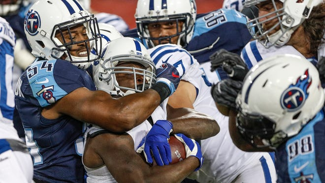 Indianapolis Colts running back Frank Gore (23) is wrapped up by Tennessee Titans inside linebacker Avery Williamson (54) at Nissan Field in Nashville, Tenn., on Monday, Oct. 16, 2017.