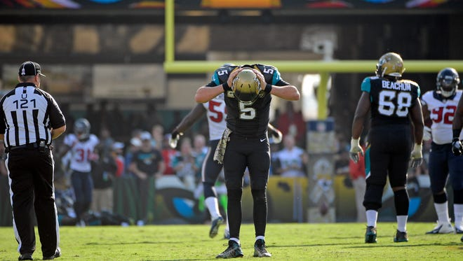 Jacksonville Jaguars quarterback Blake Bortles (5) reacts after throwing an incomplete pass to an open receiver against the Houston Texans during the second half of an NFL football game in Jacksonville, Fla., Sunday, Nov. 13, 2016. Houston won 24-21.
