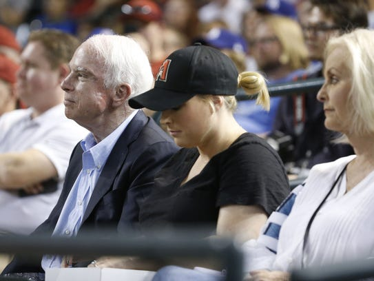 Sen. John McCain watches a Diamondbacks vs. Dodgers